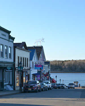 Main St. shops and Frenchman Bay, Bar Harbor, Maine