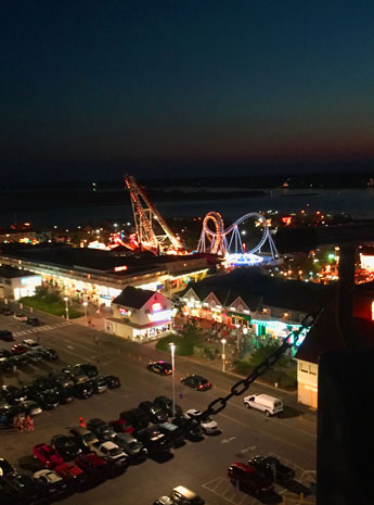 Southward view of the Inlet, Assateague Island and Trimpers Amusement rides from top of ferris wheel, Ocean City, Md.