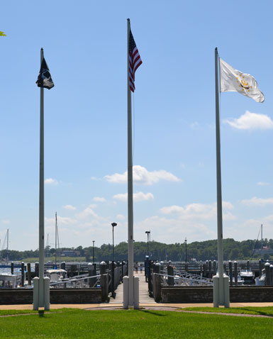 Flags overlooking Bristol Harbor at Firefighters Memorial Park, Thames St., Bristol, R.I.