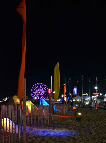 Nighttime view of Sandfest 2016 and the ferris wheel, Ocean City, Md.