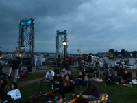 View of Memorial Bridge and Prescott Park during Prescott Park Concert Series, downtown Portsmouth, N.H.